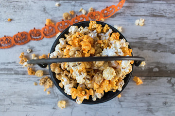 Halloween popcorn in cauldron top view