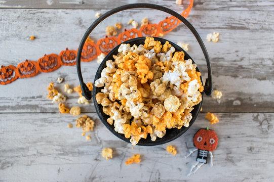 Halloween popcorn in cauldron top view