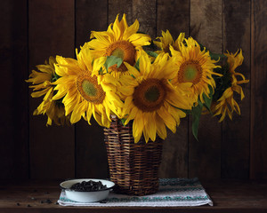 Bouquet of sunflowers in a basket.  Rustic still life.