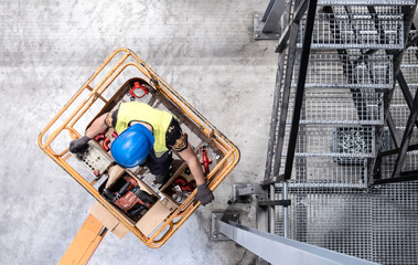 Aerial of a worker on a cherry picker Wall mural