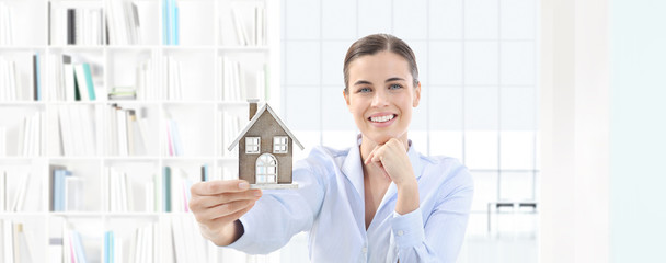home concept smiling woman showing house model, real estate and design