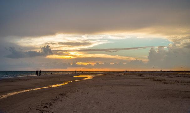 Sunset Walking down the beach