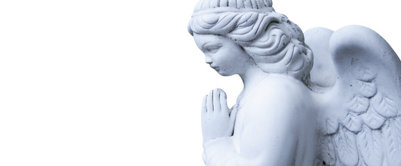 Figure of a praying angel on a white background