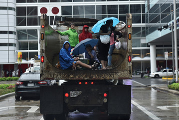 Evacuees are transported to the George R. Brown Convention Center after Hurricane Harvey inundated the Texas Gulf coast with rain causing widespread flooding