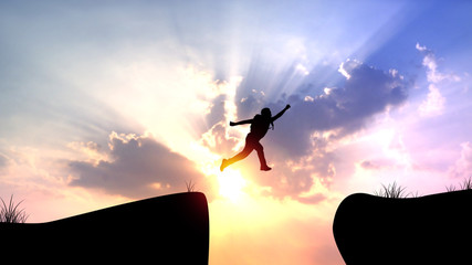 silhouette man jumping on cliff, concept as success , freedom and winner