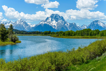 Mount Moran at Oxbow Bend of Snake River - Spring clouds passing over snow covered Mount Moran at Oxbow Bend of Snake River in Grand Teton National Park, Wyoming, USA.