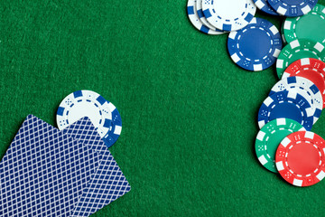Casino green table with chips and play cards