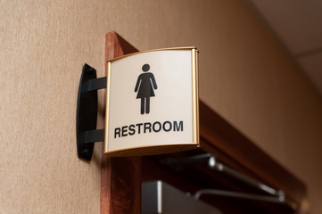 Women restroom sign close up