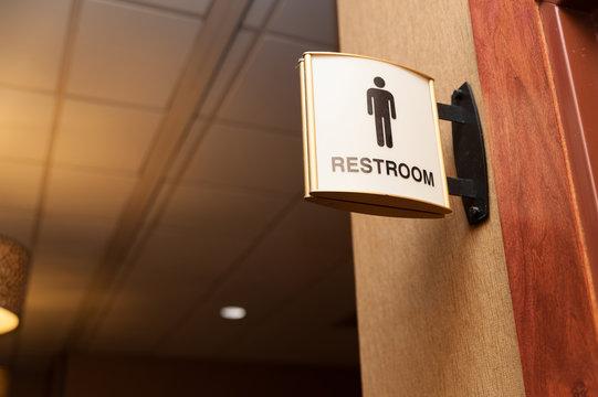 Public men restroom sign close up image