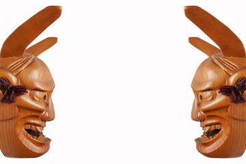 Twin side face of Traditional japanese theater masks made of wood