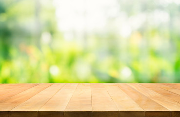 Empty of wood table top on blur of fresh green abstract background .For montage product display or key visual layout