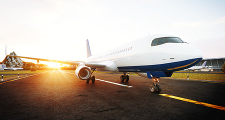 White commercial airplane standing on the airport runway at sunset. Front view of passenger airplane is taking off. Airplane concept 3D illustration.