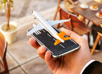 Smartphone application for online searching, buying and booking flights on the internet. Online check-in. Unusual 3D illustration of commercial airplane taking off on smart phone in hand