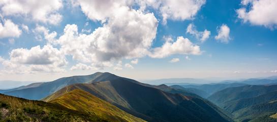 panoramic view of alpine mountain ridges