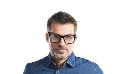Mature hipster man in denim shirt. Studio shot, isolated.