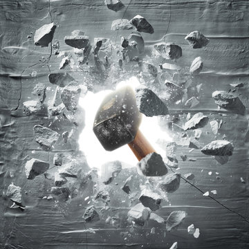 hammer hitting the wall