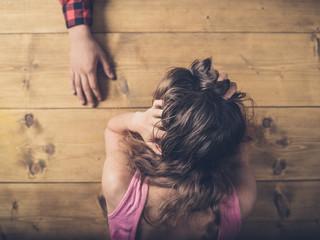 Man comforting sad and upset woman at table