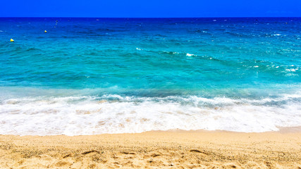 Empty Beach and ocean as  background with copy space. Sandy beach, blue sky and sea. Summer relax concept.
