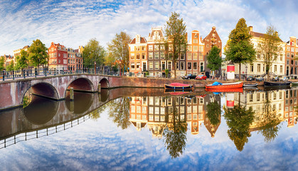 Foto op Plexiglas Amsterdam Amsterdam Canal houses vibrant reflections, Netherlands, panorama