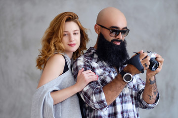 Amateur bearded photographer and a redhead female.