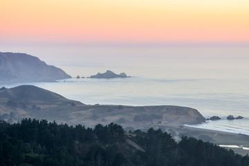 Summer Haze Sunset over San Mateo Coast. Milagra Ridge, Pacifica, San Mateo County, California, USA.