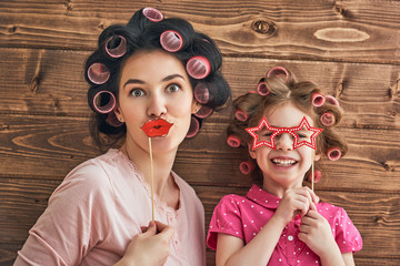 Mother and daughter with paper accessories