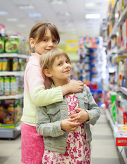 Two sisters in   toy store