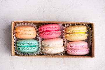 Foto auf Leinwand Macarons Sweet macarons. Different french cookies macaroons in a paper box.