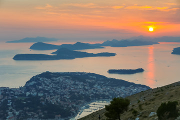 A view of Elafiti islands in the Adriatic sea next to Dubrovnik at sunset.