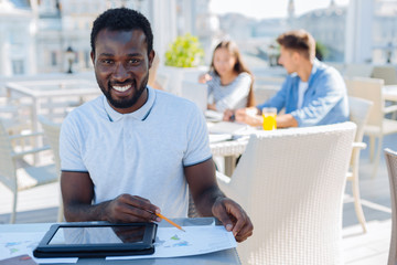 African american student studying outdoors alone