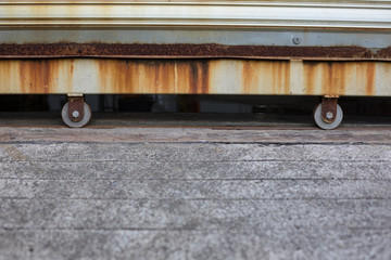 Steel sliding door on wheels.