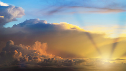 Rays of light shining through clouds, dramatic sky with cloud