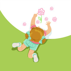 Little girl lying on her stomach and painting flowers with her hands, top view of child on the floor