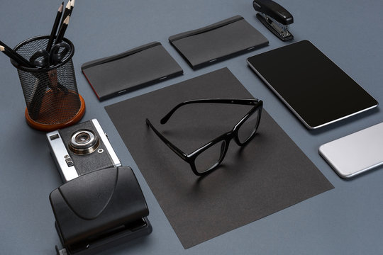 Black office stuff collection flat lay. Top view on set of stationery with smartphone and tablet