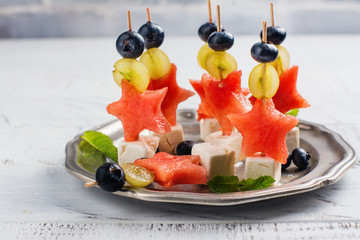 Little skewers with water melon and feta cheese. Copy space