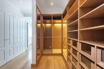Cabinets and an empty dressing room made of wood, for family.