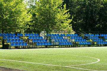football field with bleachers