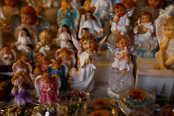 Angel statues are displayed at the street stall with devotional articles near Jasna Gora Monastery in Czestochowa