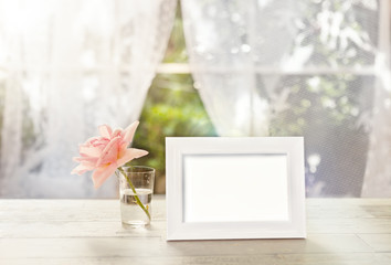 White frame mockup with rose in glass