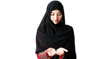 Portrait of beautiful young muslim woman on a white background.