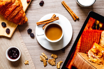 breakfast at home on wooden table with cup of  coffee