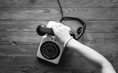 Vintage telephone, coffe, biscotti, phone call, sad woman, free space for text.