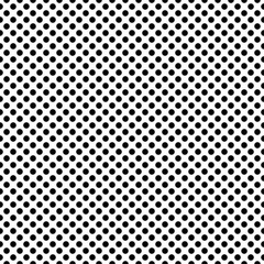 Dotted dense monochrome vector seamless pattern. Polka tile background in black and white.