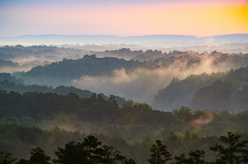 View from an overlook of rolling hills at sunrise near Cheaha Mountain in Alabama, USA