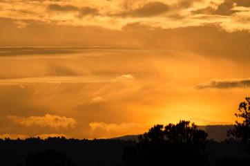 Golden predawn clouds over the hills near Anniston, Alabama, USA