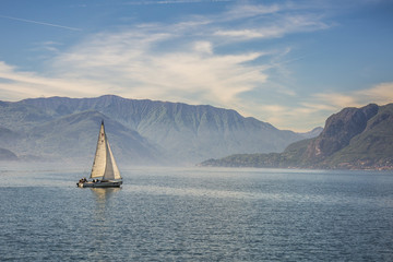 Sail boat on the waters of Lake Como, Lombardy, Italy.