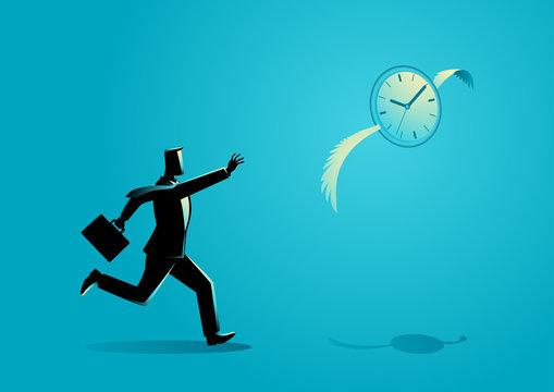 Businessman chasing a flying clock