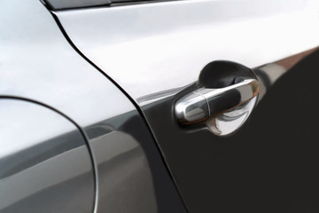 The side door of the black car Used as a handle to open the door.