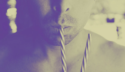 Man drinking from straws with retro style color.  Abstract image for art.