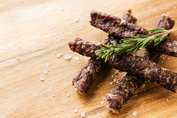 Droewors (biltong) on a wooden board. This is a popular South African food snack.